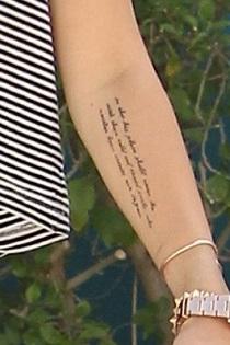 miley arm tattoo
